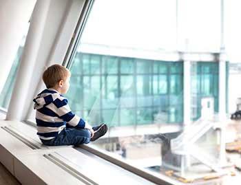 Boy watching plane