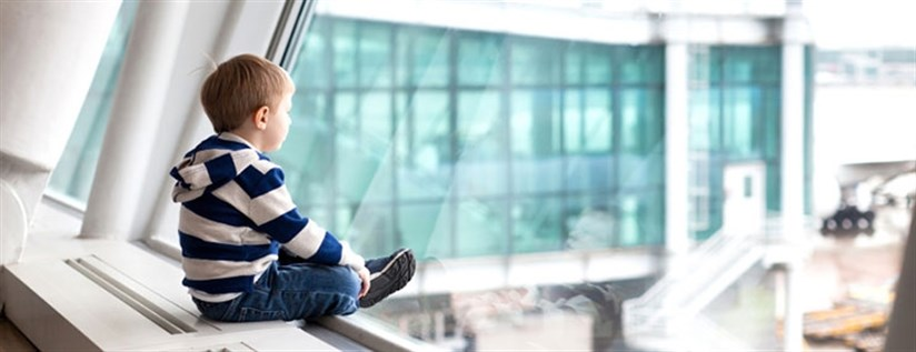 First Time Flyer Header - Boy Watching Plane